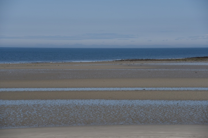 Cloughey beach from churchyard